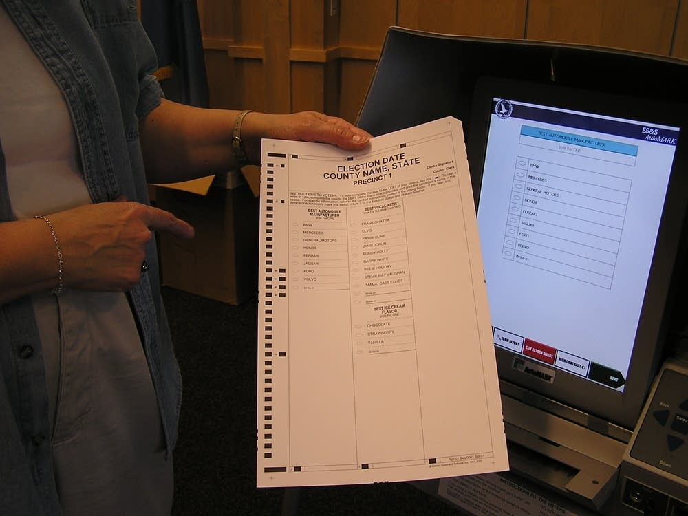 The machine scans the ballot