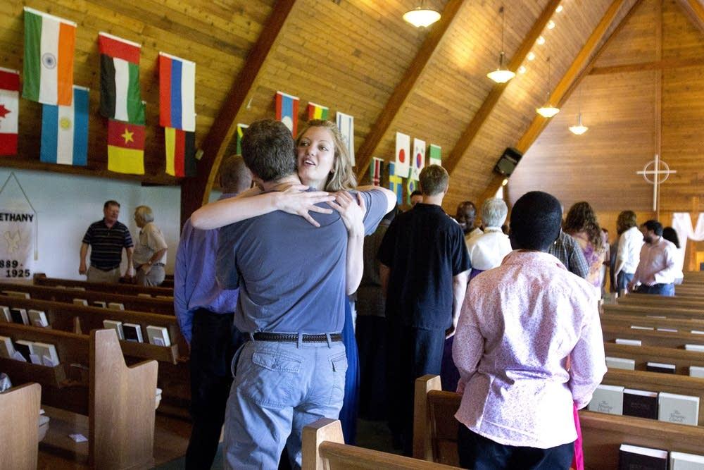 Laura Newby greets a fellow congregant