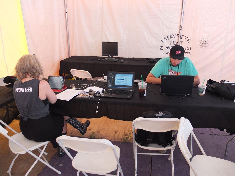 Jade and Matt Perkins working in the media tent