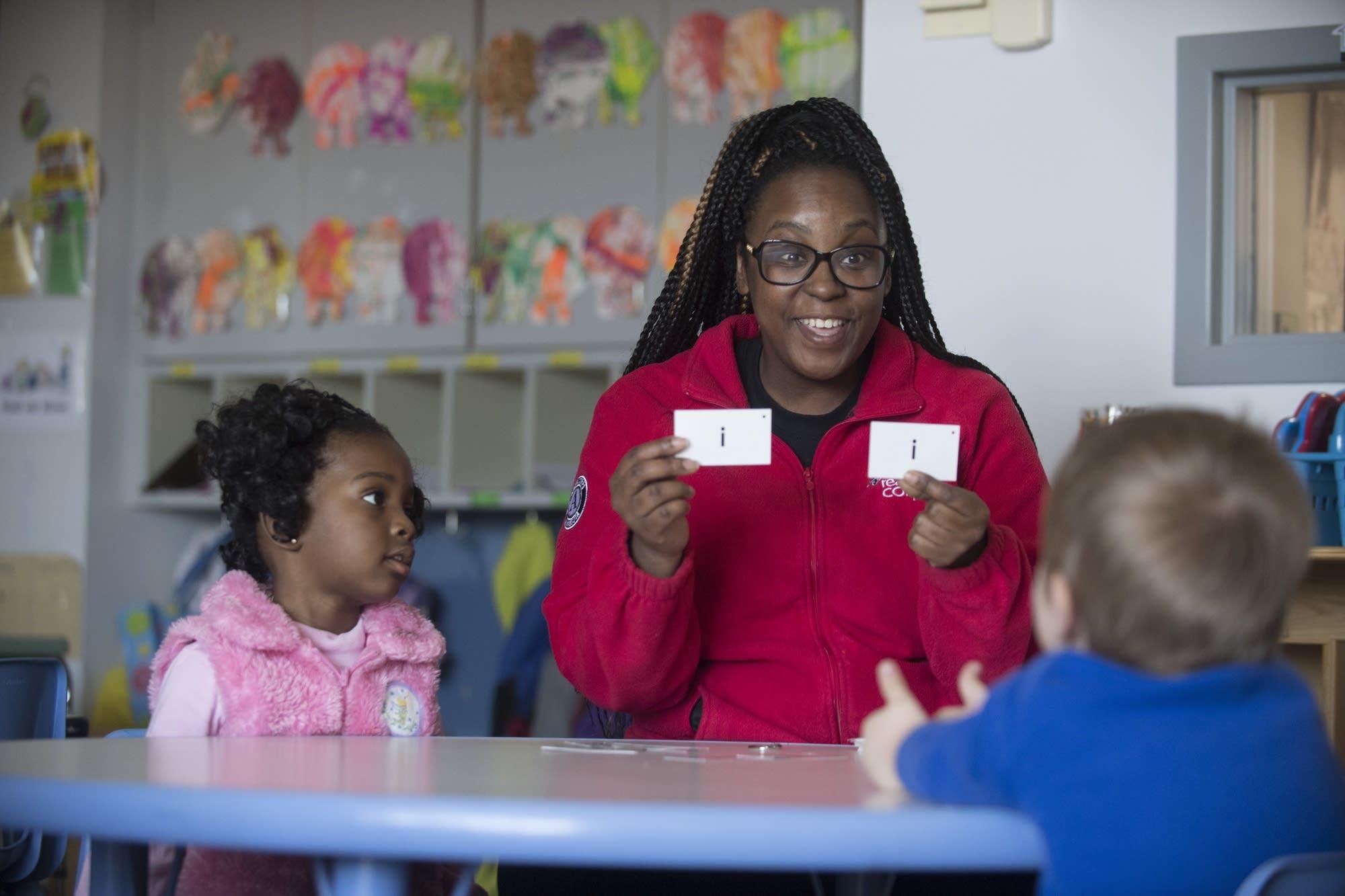 Tutor LaRae Carlisle works with children.