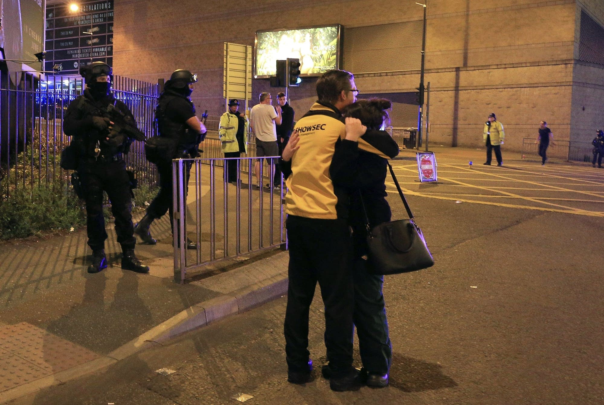 Uk police 19 confirmed dead in blast at ariana grande concert armed police stand guard at manchester arena after reports of an explosion m4hsunfo