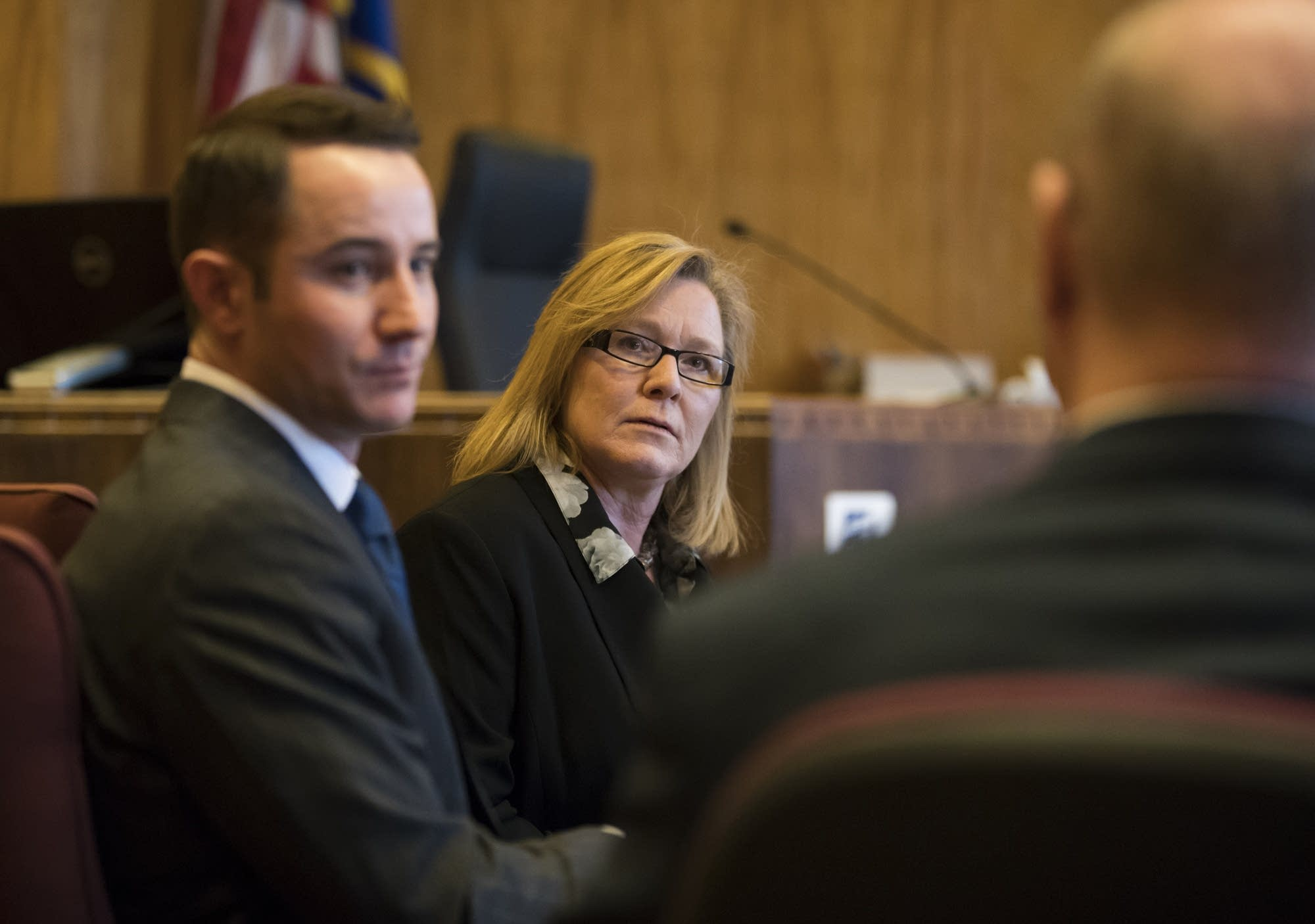 Lt. Gov. Michelle Fischbach chats with her lawyers.
