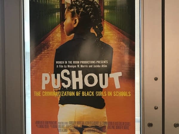 "A poster advertising a showing of the documentary ""Pushout"""