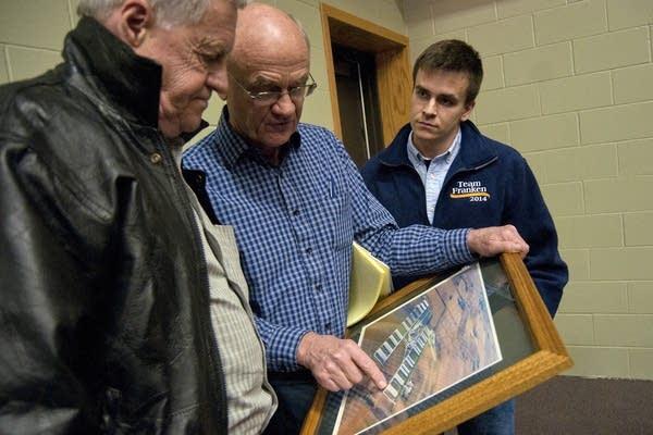 Bob Sonstegard showed a photo of his farm.