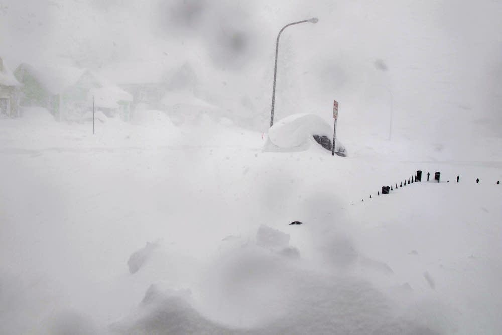 A 4-foot fence and SUV are nearly buried