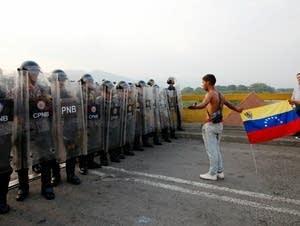 Venezuelans confront national guard members