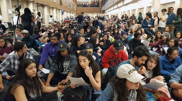 Hundreds of student pack an administration building