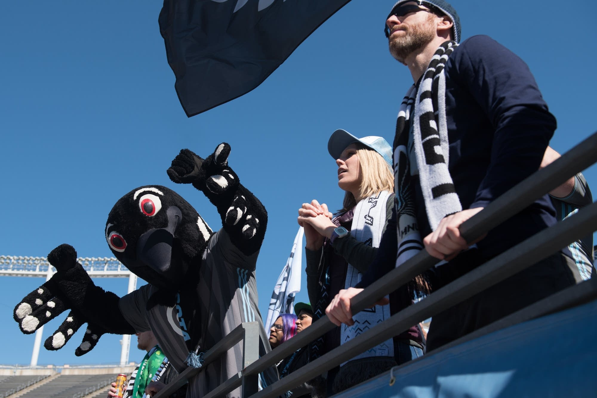 Fan groups are joined by the Minnesota Loon mascot.