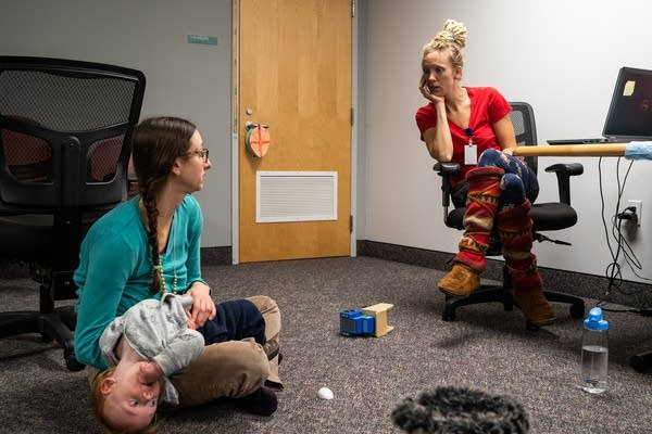 Nurse Amy Schmidt works with Amanda Weberg and her 1-year-old son Odin.