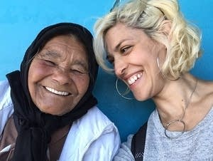 Dessa shares a laugh in Elsie's River Township, South Africa.
