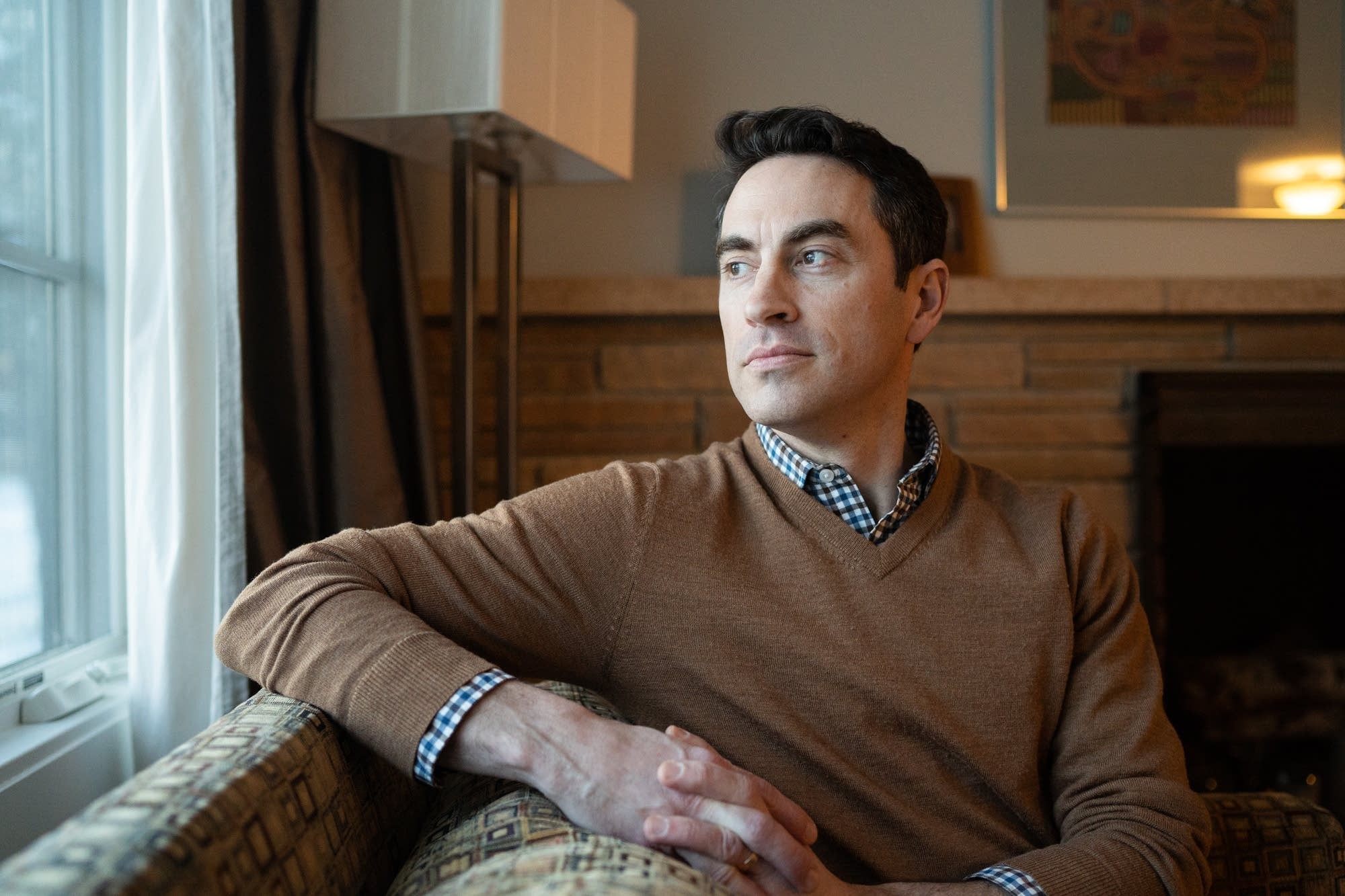 Chip LaCasse sits for a portrait inside of his family's Edina, Minn., home
