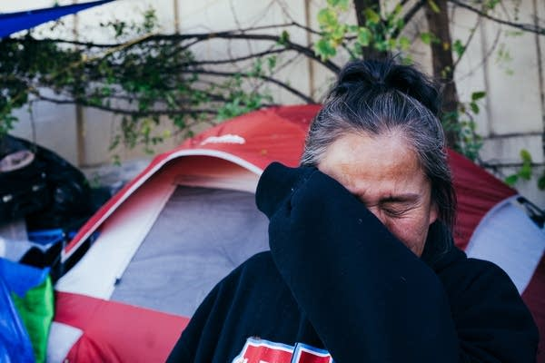 Maggie Thunder Hawk tears up as she talks about finding housing.