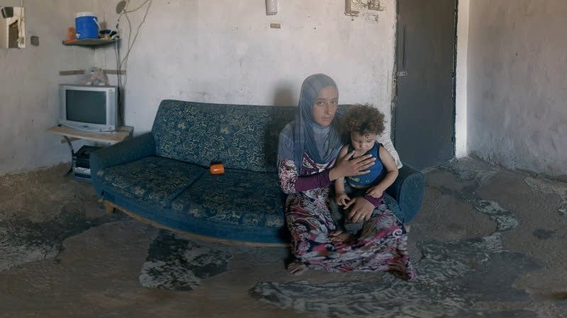 A Syrian woman and her child