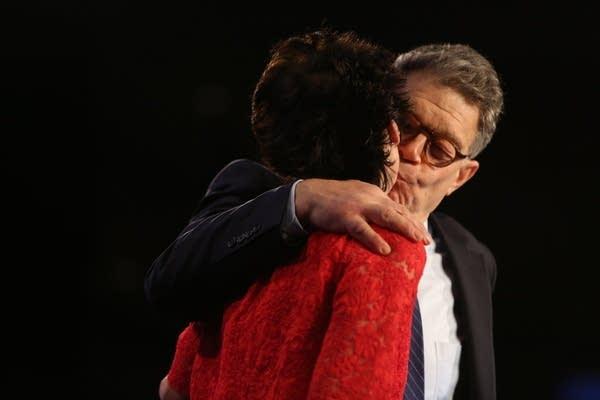 Franken kisses his wife, Franni