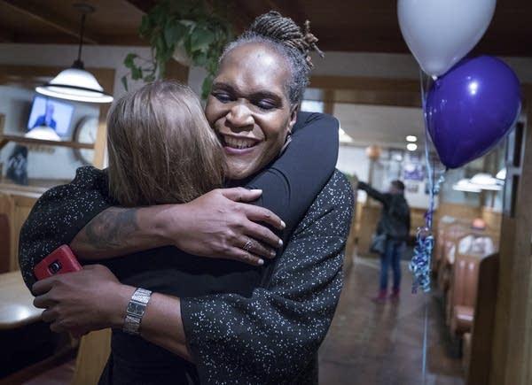 Andrea Jenkins hugs a supporter.