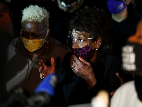 Rep. Maxine Waters, D-Calif., joins demonstrators in a protest
