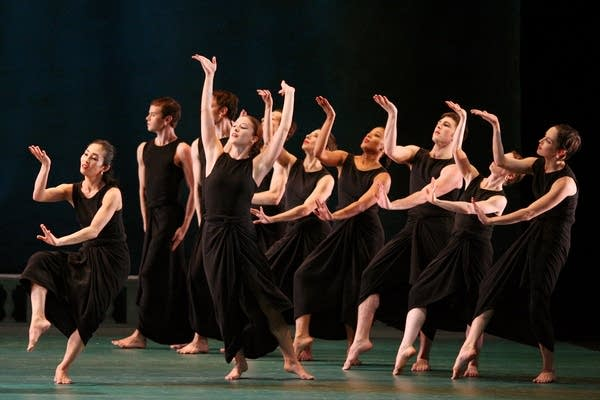 Dancers use gestures to adopt different personas.