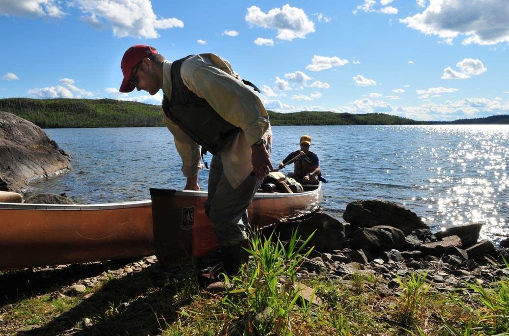 Pulling canoe onshore