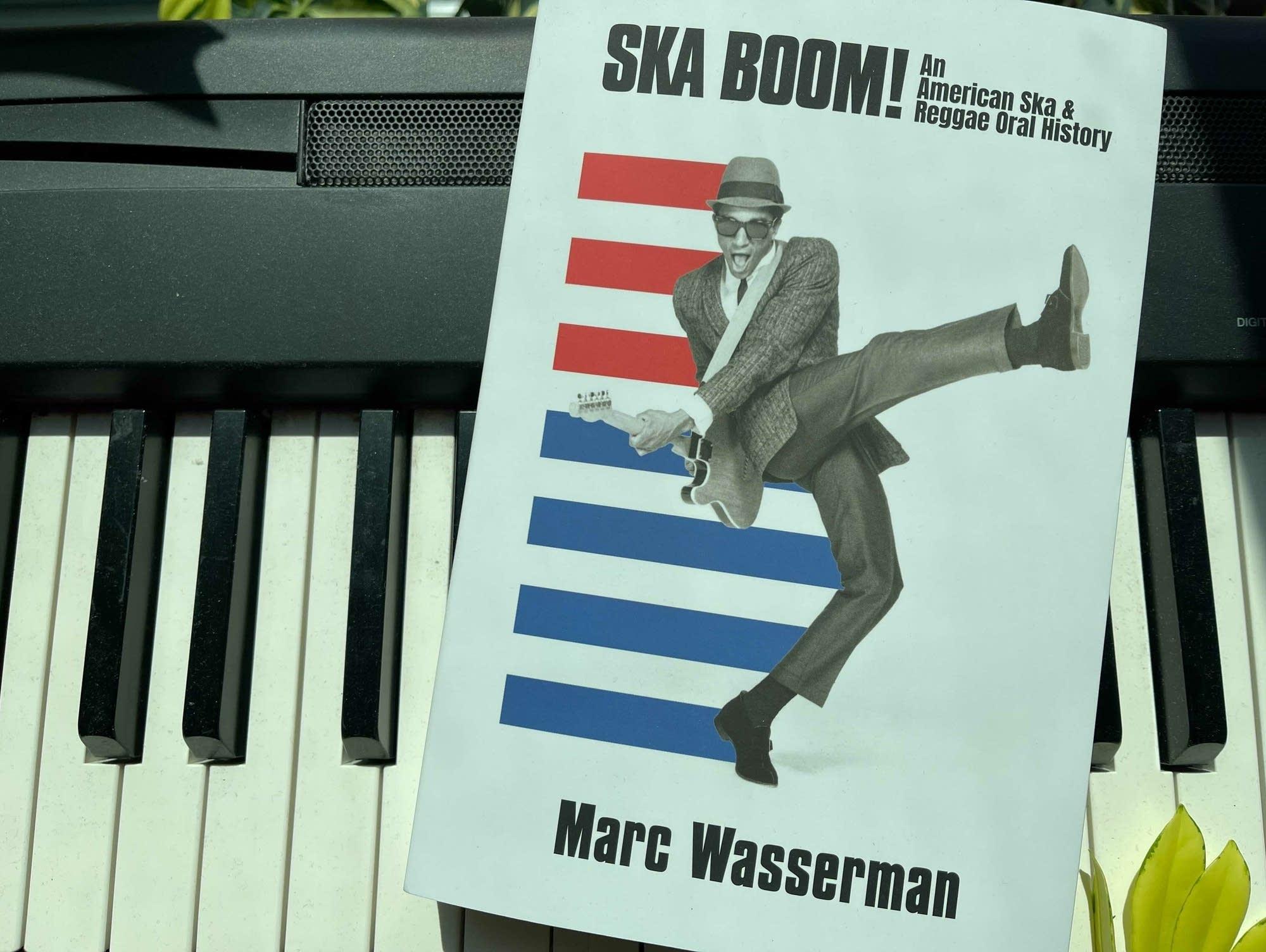 Book on keyboard: 'Ska Boom! An American Ska & Reggae Oral History.'