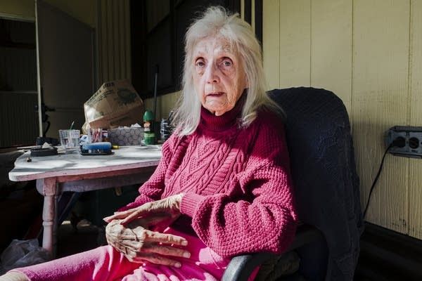 Jean Christianson sits on her patio.