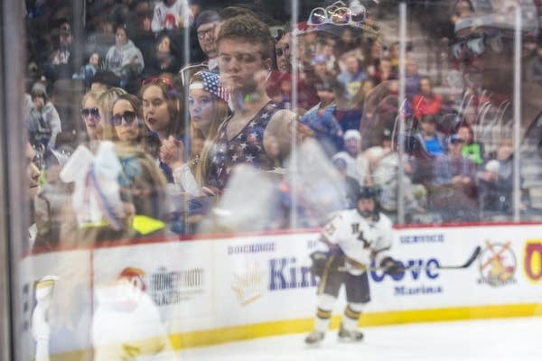 The Hermantown student section is reflected in the glass
