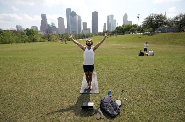 Trey Evans participates in an online yoga class.