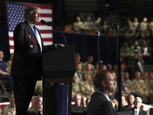 President Donald Trump speaks at Fort Myer in Arlington Va.