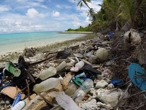 Debris blankets the north side of one of the Cocos Keeling Islands.