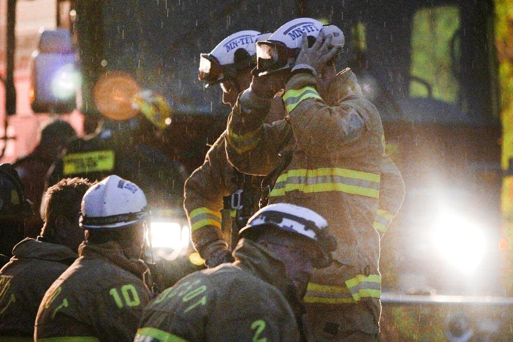 Light rain falls on emergency crews