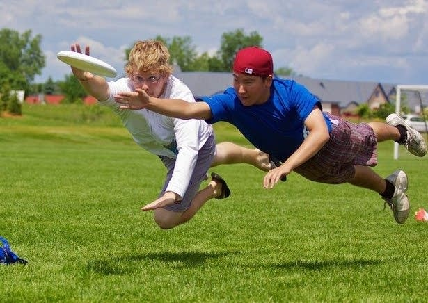 Kevin Held (red cap) playing Ultimate