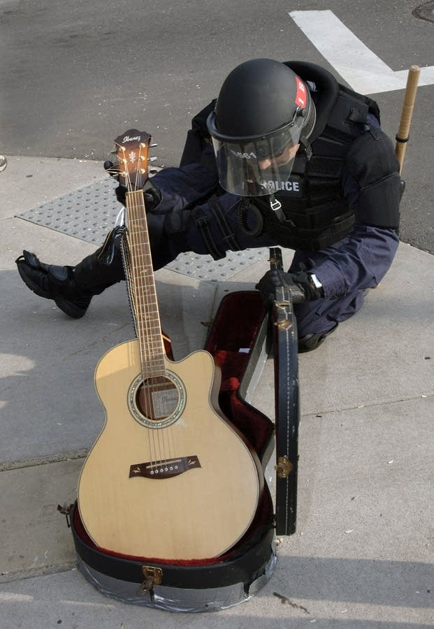 Police with guitar