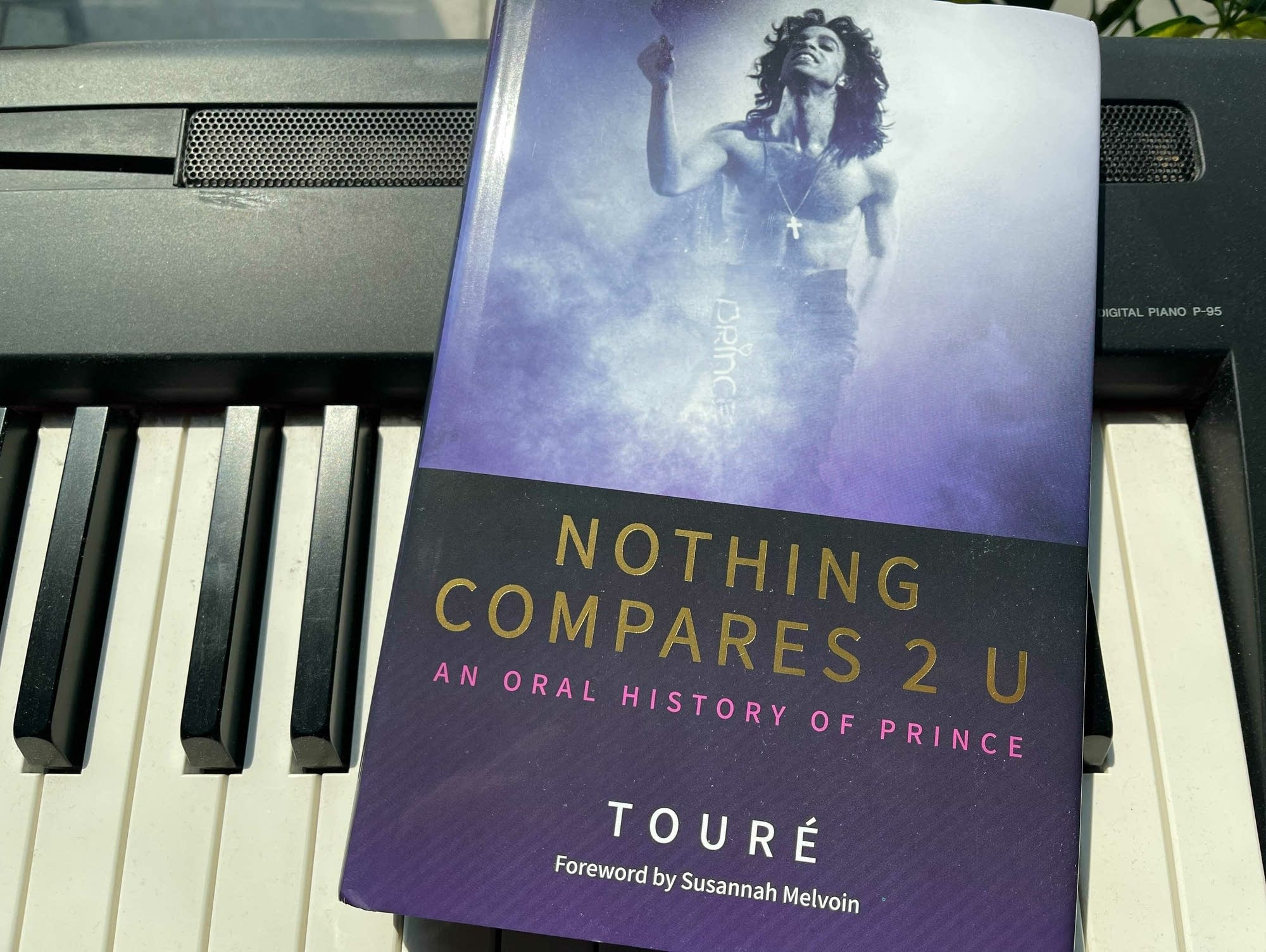 Book on keyboard: 'Nothing Compares 2 U' by Toure.