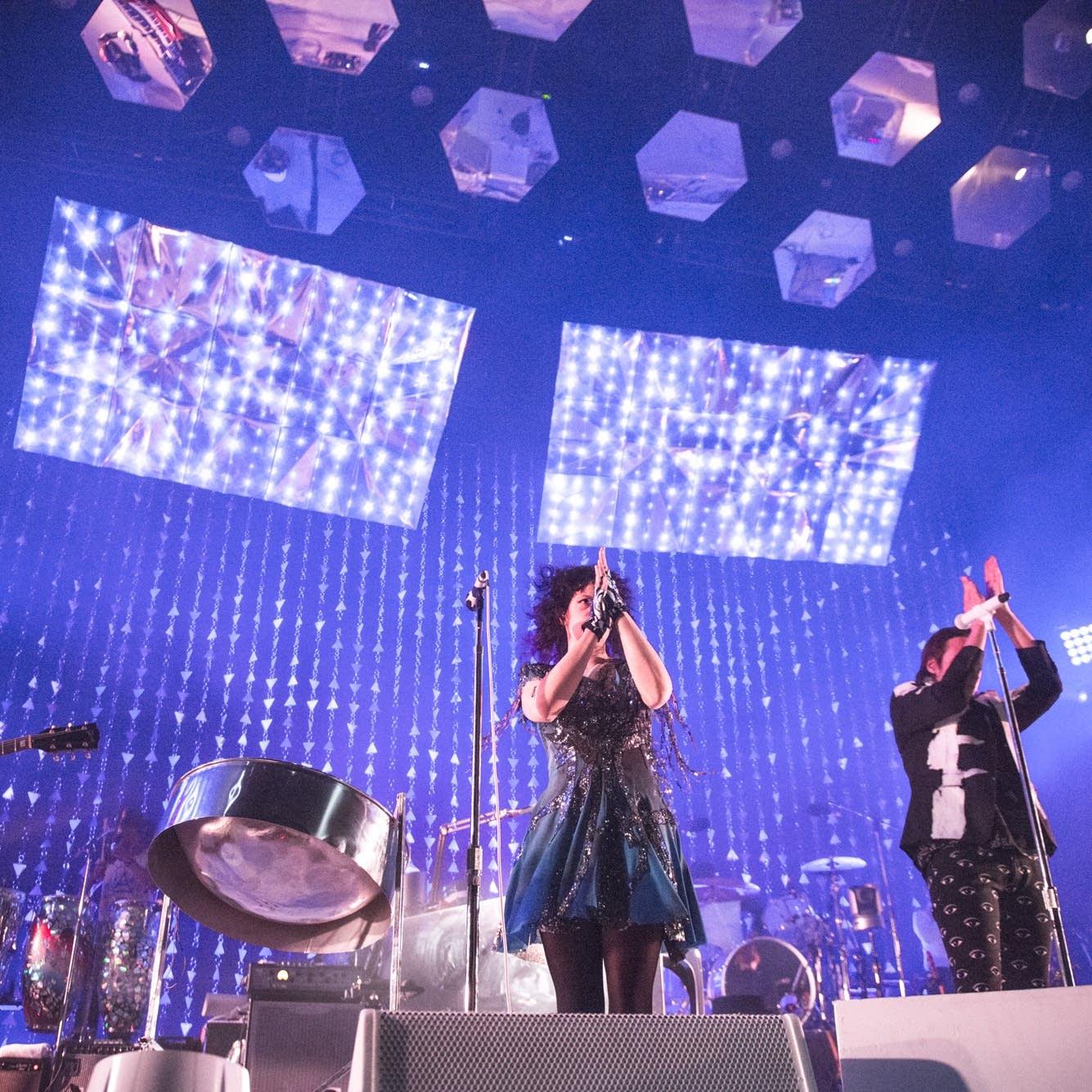Arcade Fire applauds the audience
