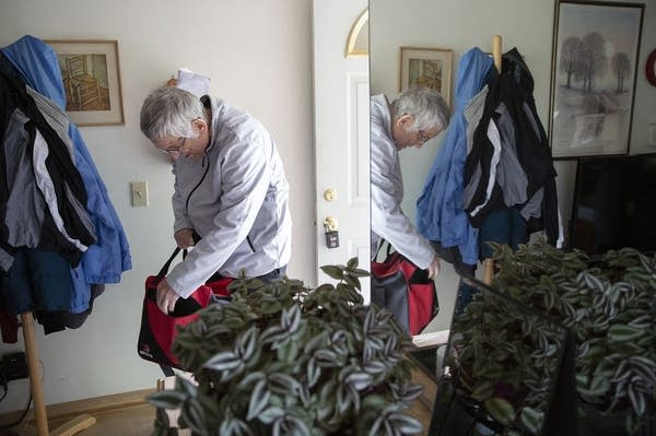 Garry Nims checks his bowling bag at his home.