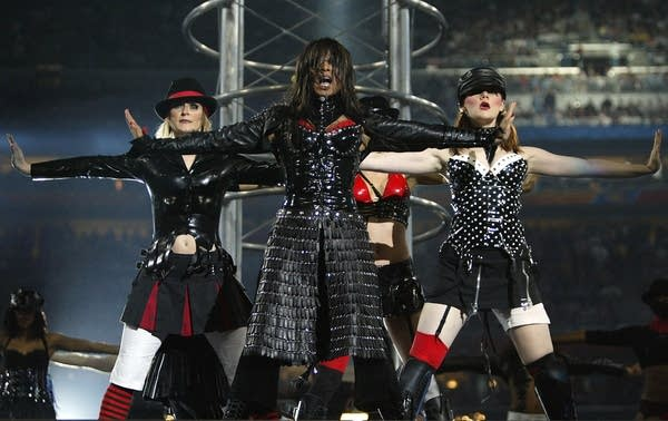 A group of dancers perform on stage