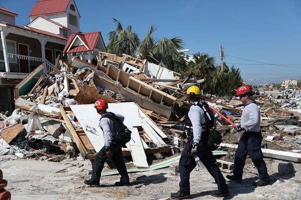 Rescuers search for survivors.