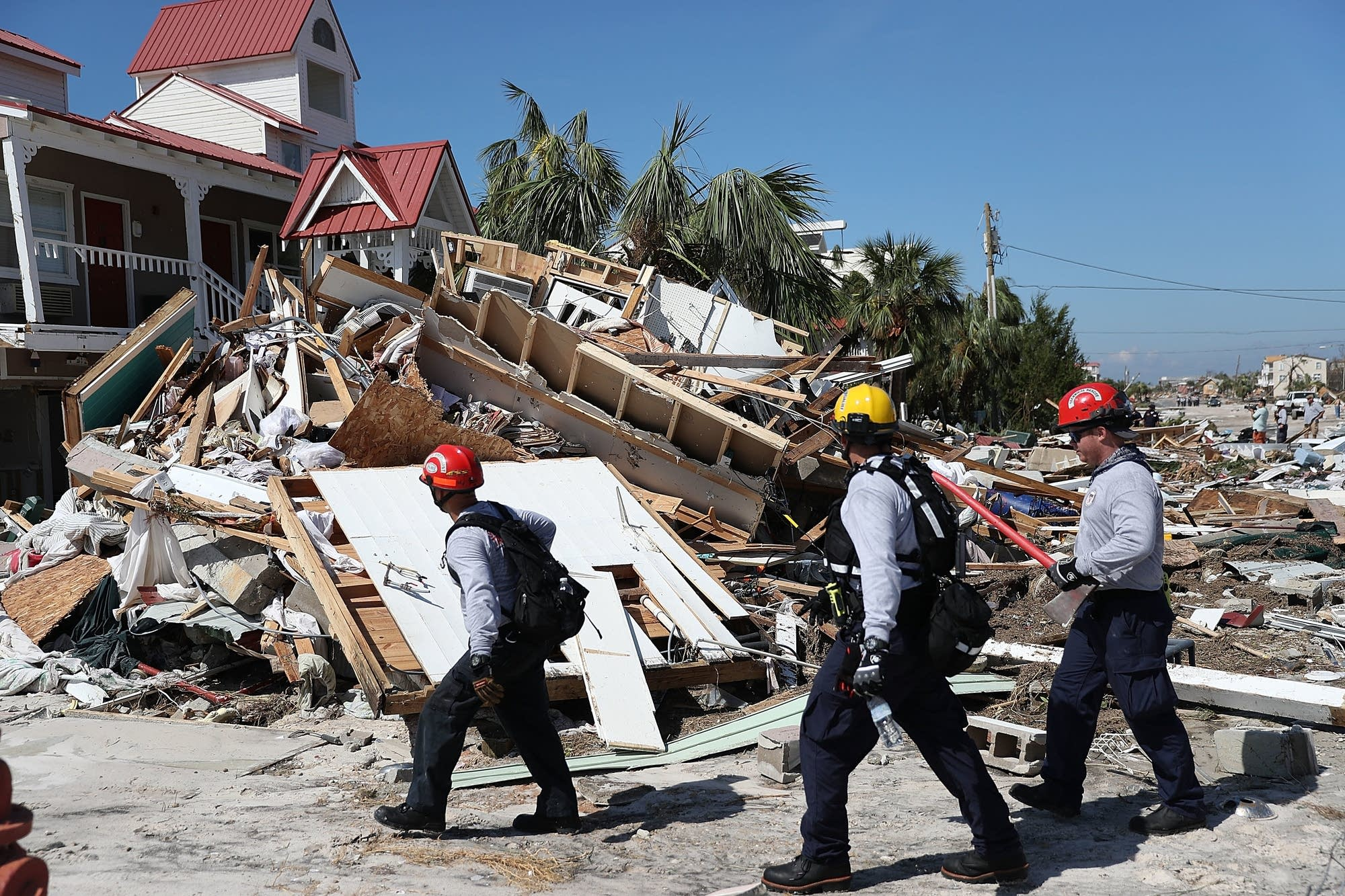 Rescuers search for survivors.