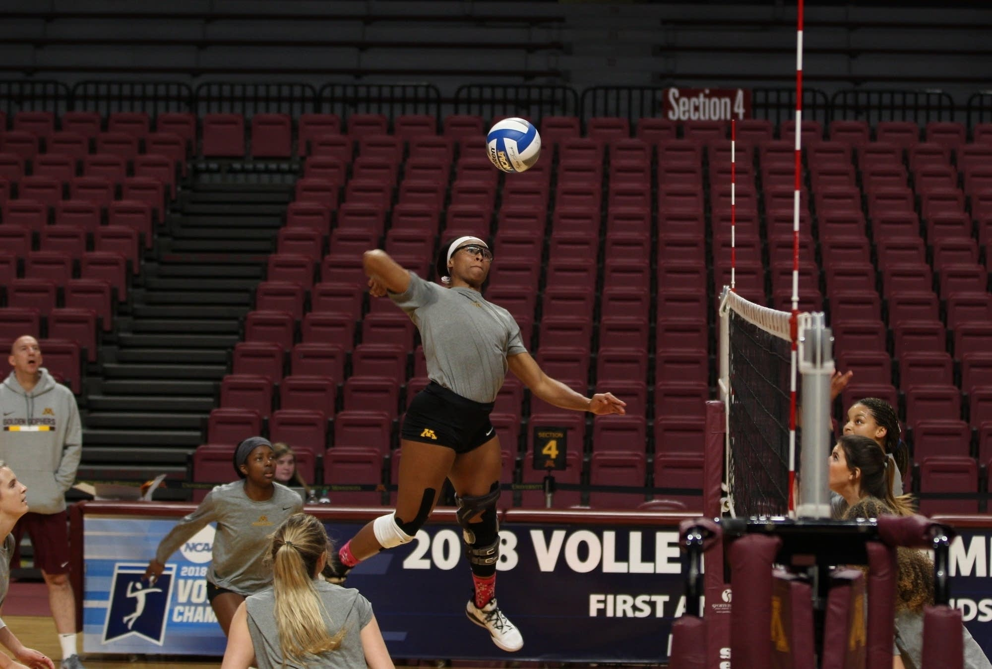 University of Minnesota Junior Taylor Morgan winds up to spike the ball