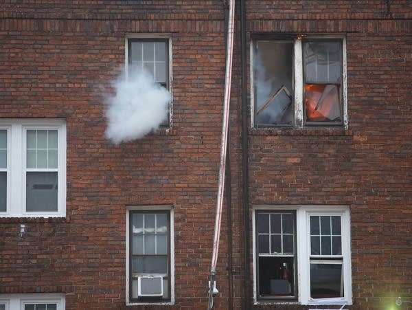 Smoke billowing out of building.