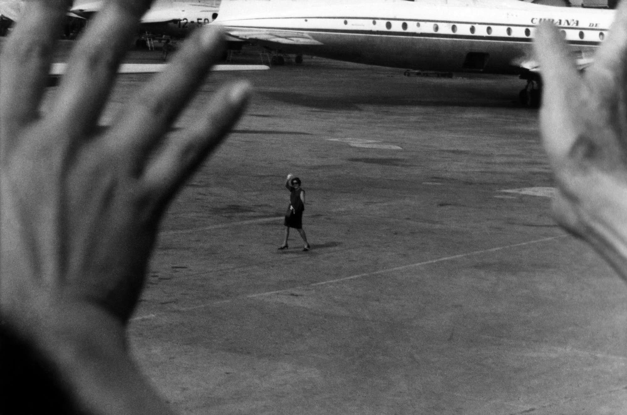 1967 image by Cuban photographer Jose Figueroa of his mother leaving Cuba.