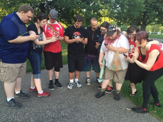 A group of people playing Pokémon Go