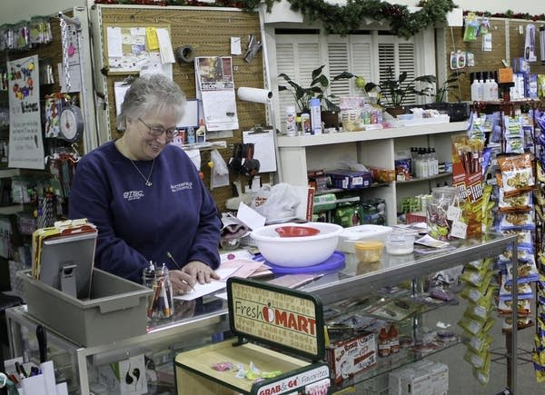 A person at a store counter.