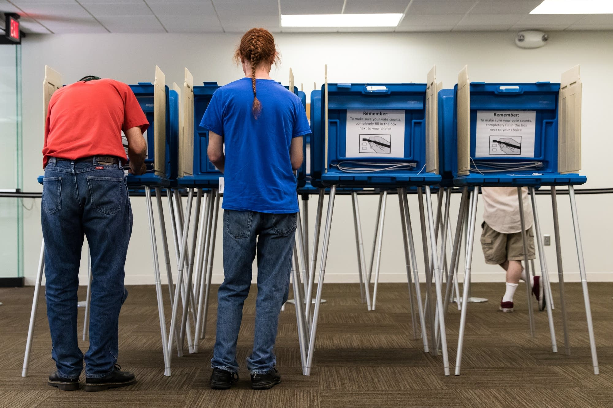 Voters fill out their primary ballots.