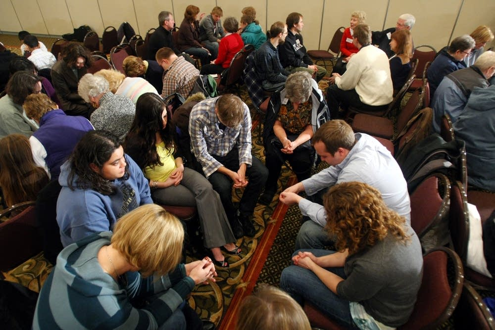 Fargo area residents pray  during a service Sunday