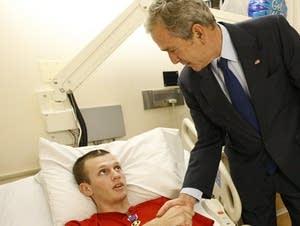 President Bush presents a Purple Heart to Army PFC Luka Shook.