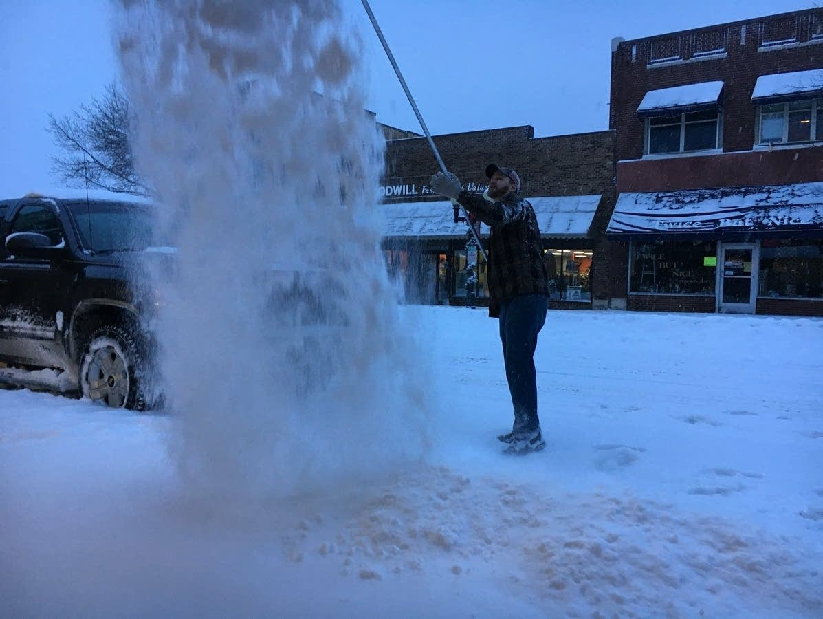 Tyler Winkka shovels the roof of the Fusion dance studio in Bemidji