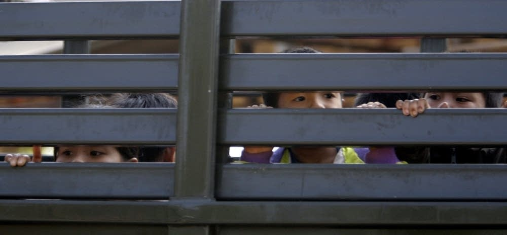 Hmong children leaving Thailand