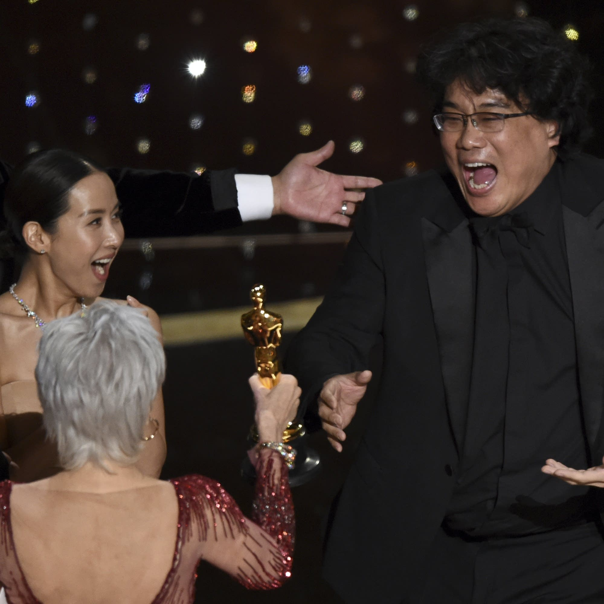 Bong Joon Ho reacts as he is presented with the award for best picture
