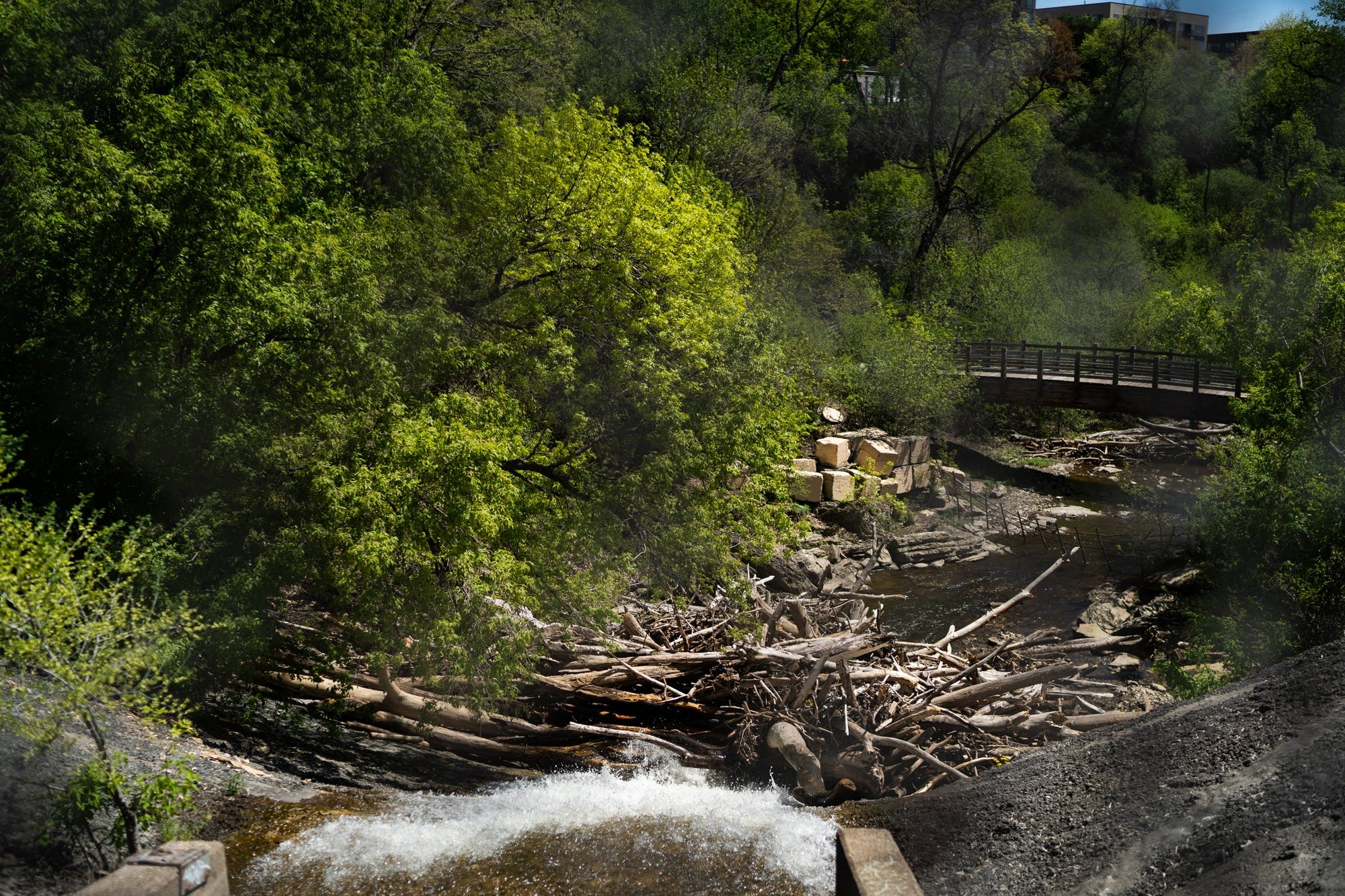 Wooden debris piles up at the bottom of the side spillway.