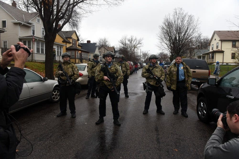 Police officers block a street in north Mpls.